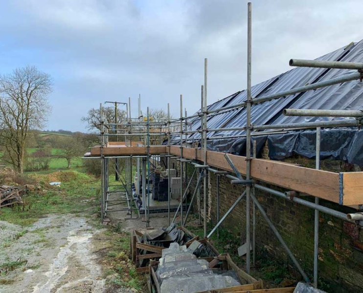 The old barns already had scaffolding, however, it was poor quality, so we dismantled them and erected our own scaffolding.